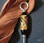 Notizzettelhalter mit orange/gelb/schwarzer Perle