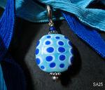 Linse in hellblau/dunkelblau/weiß